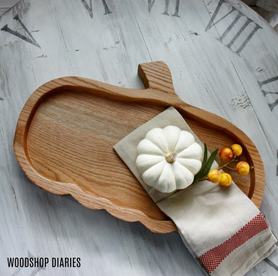 Pumpkin shaped serving tray with simple white pumpkin on top