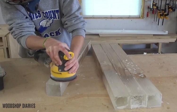 Using sander to sand down epoxy desk legs