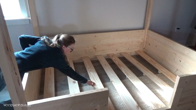 Install bed slats into kids house bed