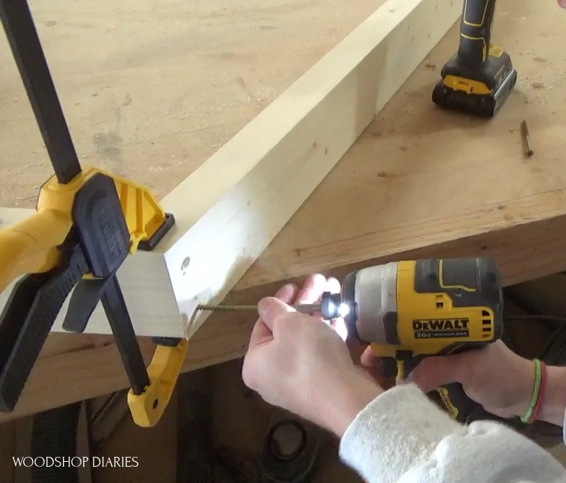 Attaching roof peak of house bed frame