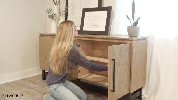 Shara adding shelf into console cabinet