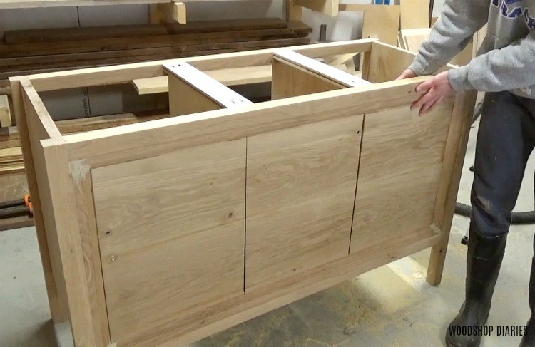 Three sections of front panel laid out on dresser console vanity piece