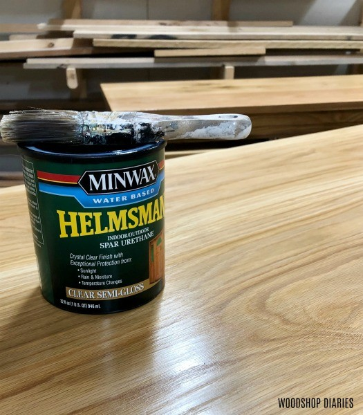 Can of Minwax Helmsman water based poly sitting on oak vanity top--how to finish raw wood furniture for water or outdoor exposure