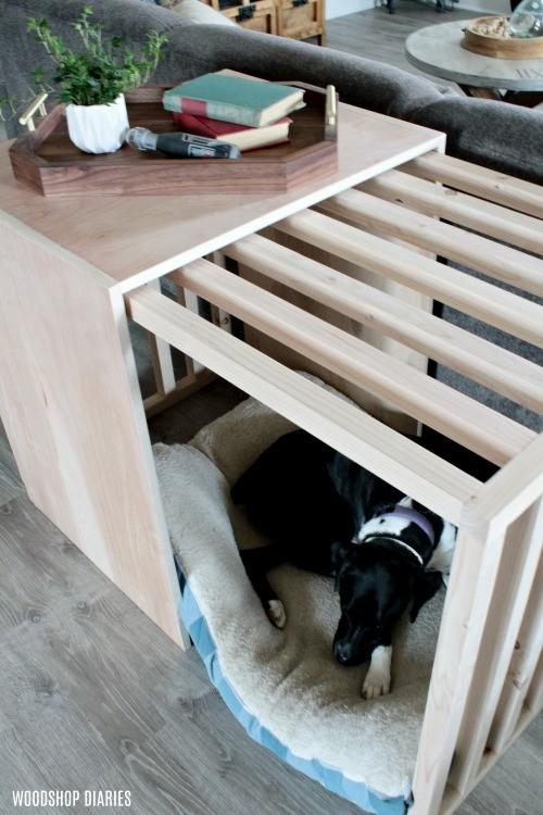 Lucy asleep in her modern slatted sliding door dog crate with door open