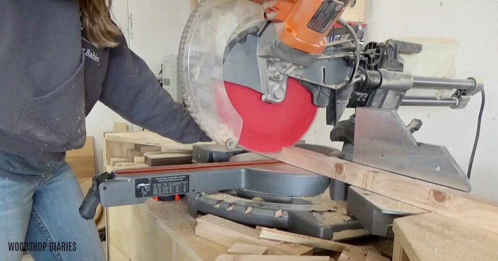Trim down 2x2s to build side panels of dog crate with miter saw