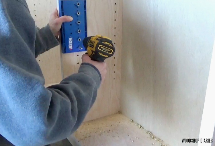 Drilling shelf pin holes into cabinet carcass on bookshelf