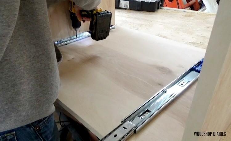 Installing drawer slides onto sliding door of dog crate