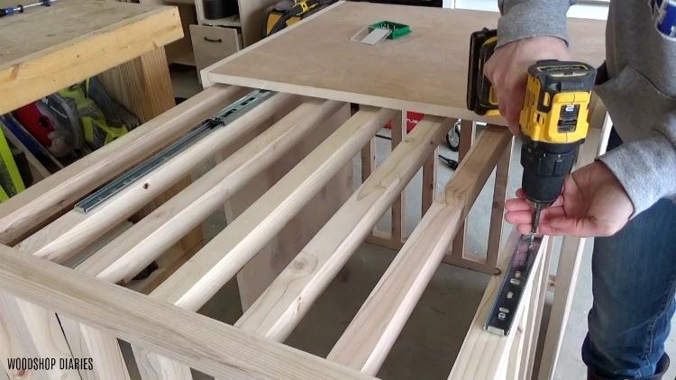 Screwing drawer slides into dog crate slats