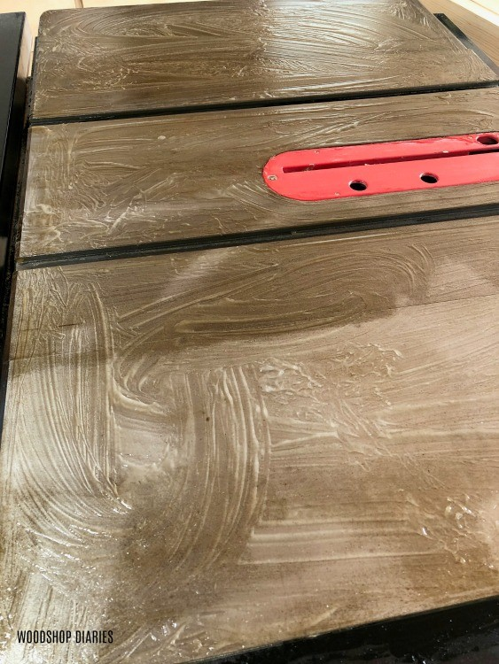 Rust remover gel smeared on table saw top surface