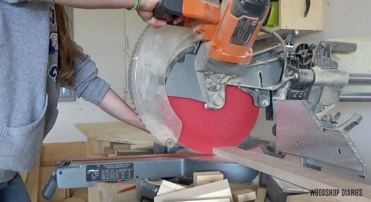 Use miter saw to trim mirror frame boards to length