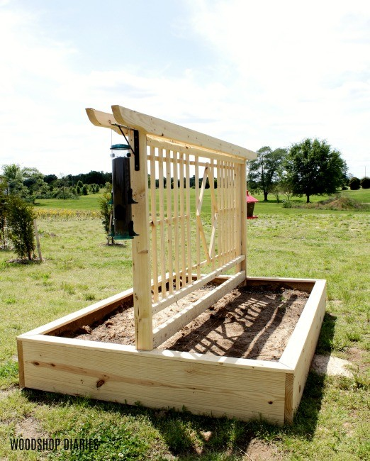 DIY Garden Bed with Trellis design angled view with birdfeeders hanging on sides