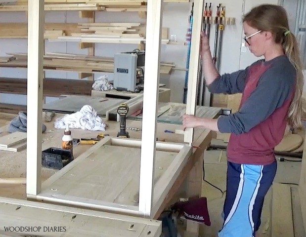 Shara Placing dresser frame supports onto side panel--using dowels and wood glue to assemble