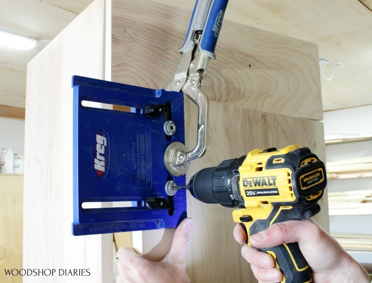 Clamp cabinet hardware jig on cabinet door to drill holes for door pulls