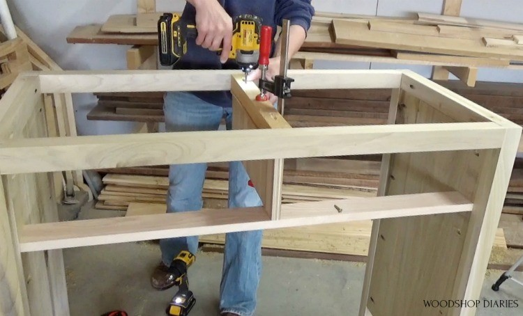 Screwing middle dresser drawer divider into place