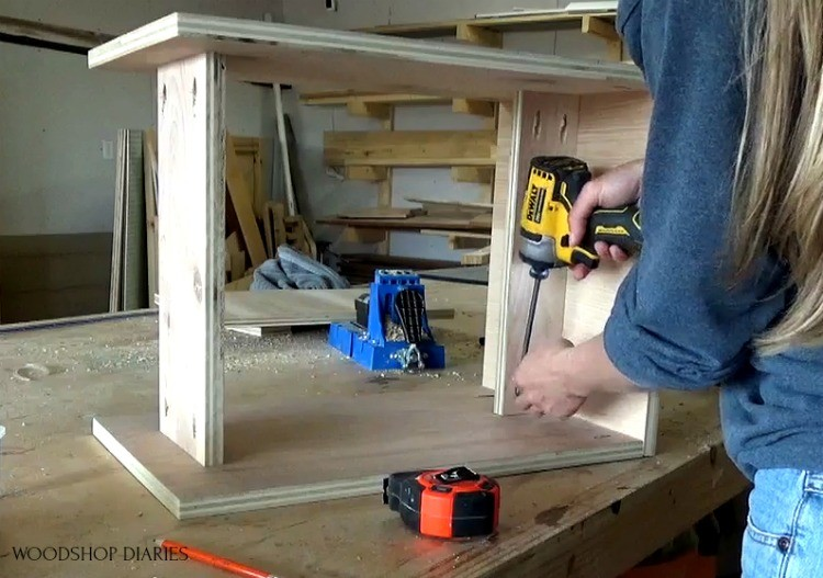 Attach seat support and shelf to plywood stool
