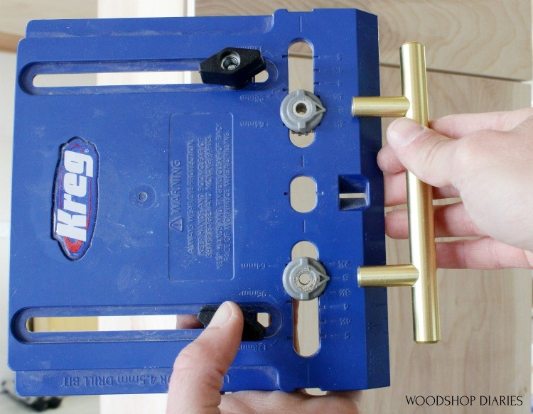 Showing settings on cabinet hardware jig to match cabinet pulls