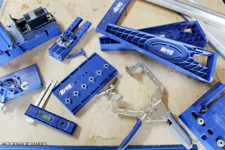 Kreg Tool Jigs laid out on workbench--these are the tools needed to build cabinets