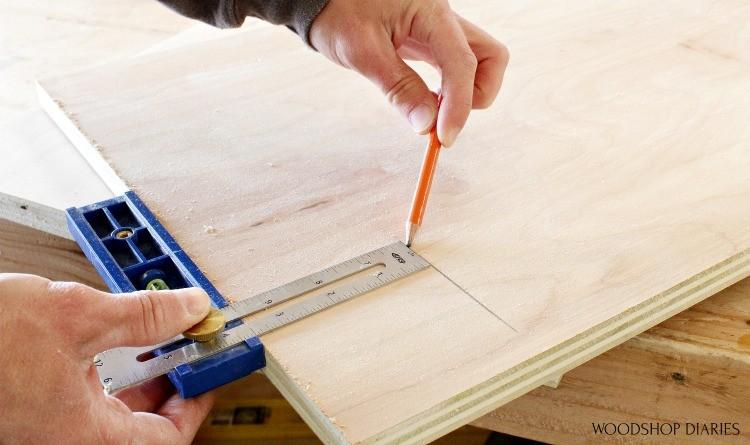 Kreg Multimark tool used to draw toe kicks on cabinet sides