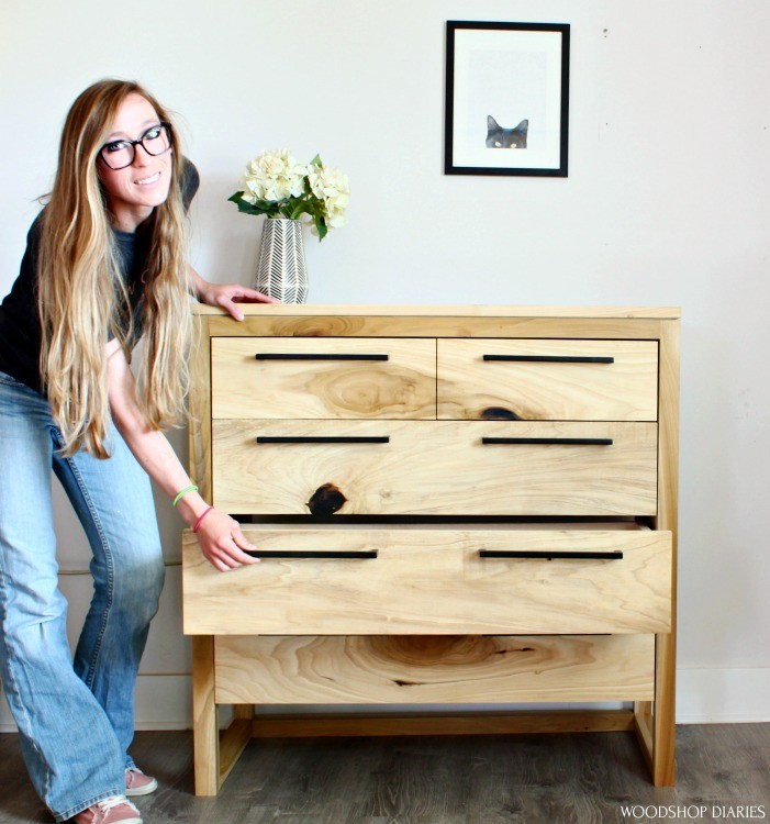 Shara Woodshop Diaries pulling drawer of DIY modern 5 drawer dresser out to show it off