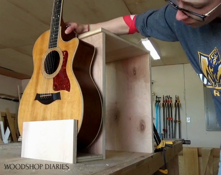 Test fit guitar into guitar stand stool combo