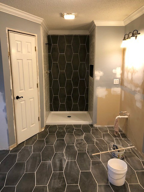 Patchy paint on walls in master bathroom--mix of tan and bluw BEFORE we painted white