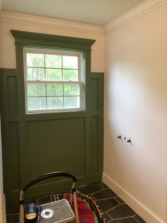 Feature wall painted Sage Green