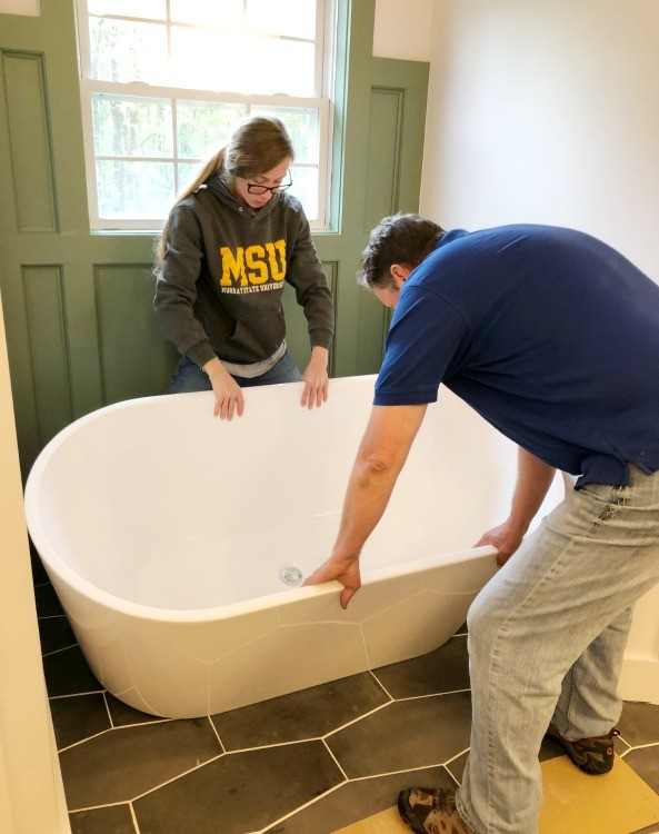 Shara and Dad install freestanding tub in master bathroom