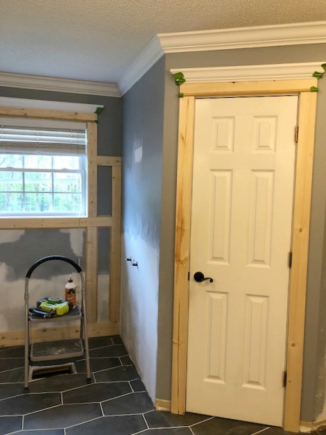 Trim installed in feature wall and doors in master bathroom