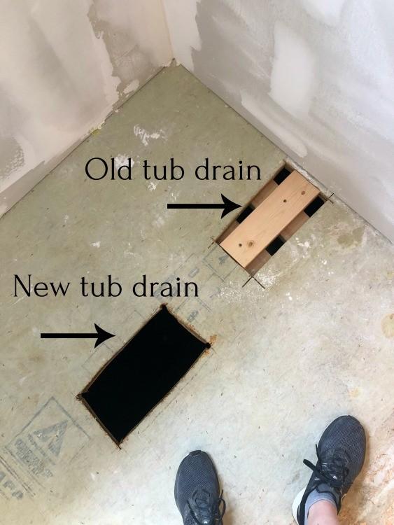 Old tub drain vs new tub drain locations in bathroom floor