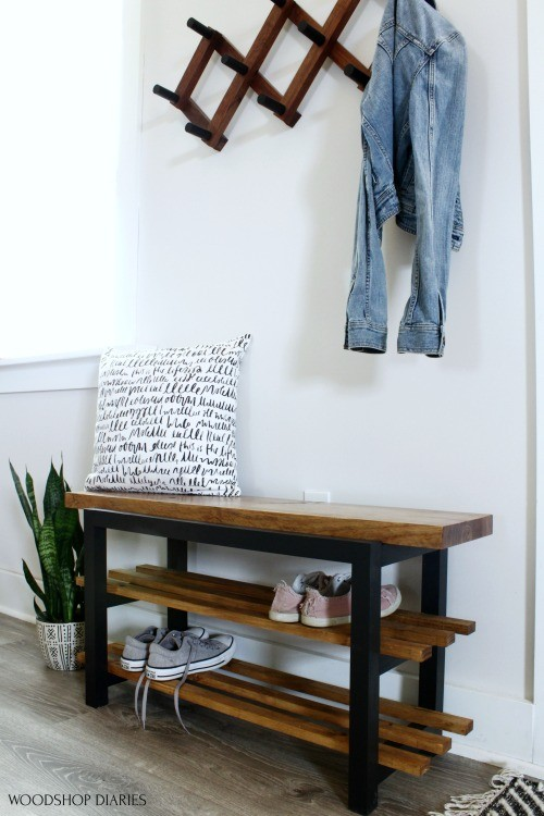 DIY shoe bench made from a single board staged in entryway