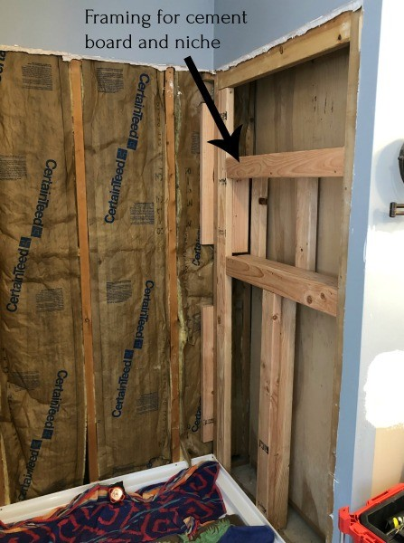 Framing installing into right wall of shower area for niche