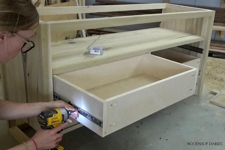 Shara installing drawer boxes into DIY modern dresser