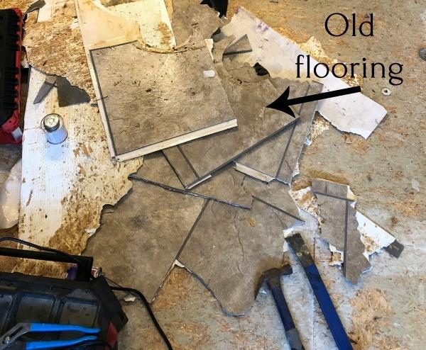 Pile of old linoleum flooring pulled off master bathroom floor