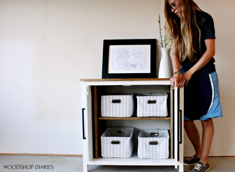 Shara with pocket door cabinet that was used as base pieces of entertainment center cabinet