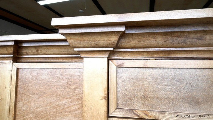Crown molding wrapped around face frame of console cabinet