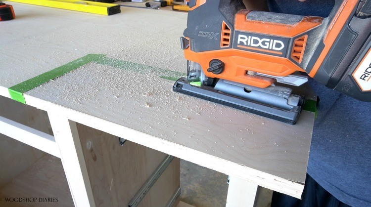 Using a jig saw to cut corners of top panel