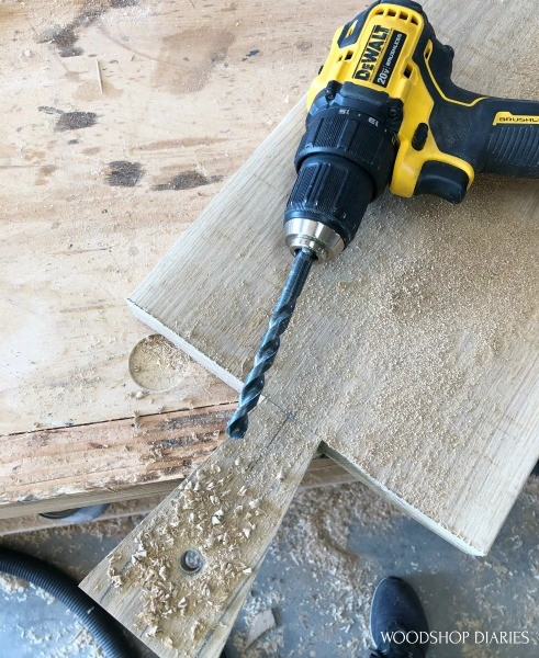 Drill used to drill hole into handle of serving board
