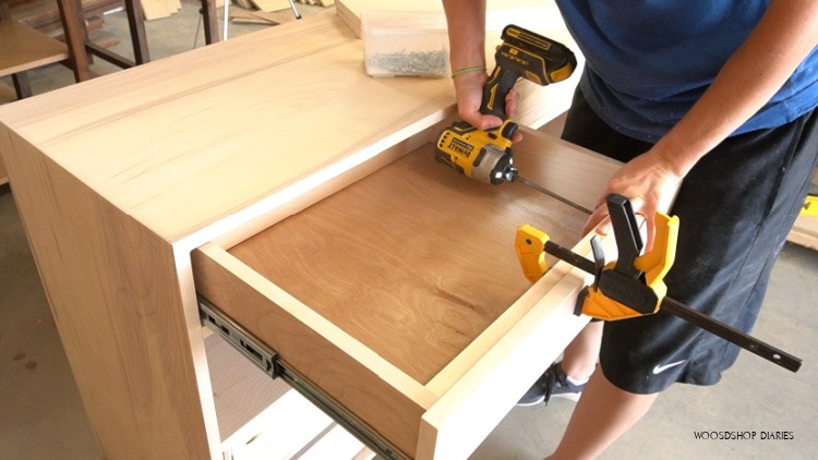 Screw drawer fronts into place from inside of drawers