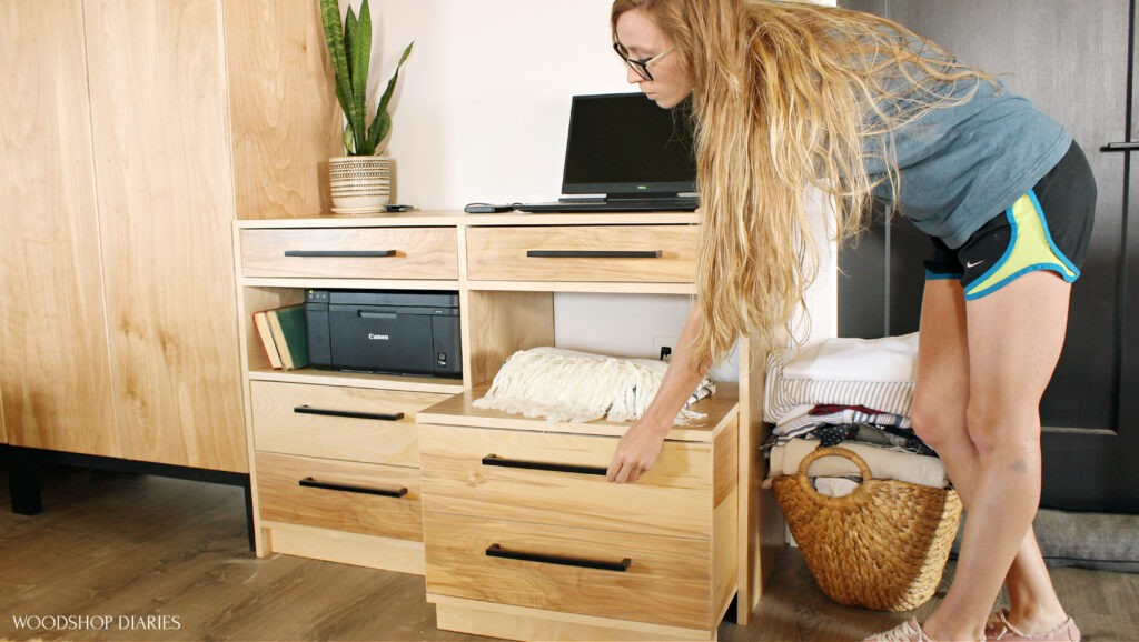 Shara Woodshop Diaries pulling storage cart seat out of desk