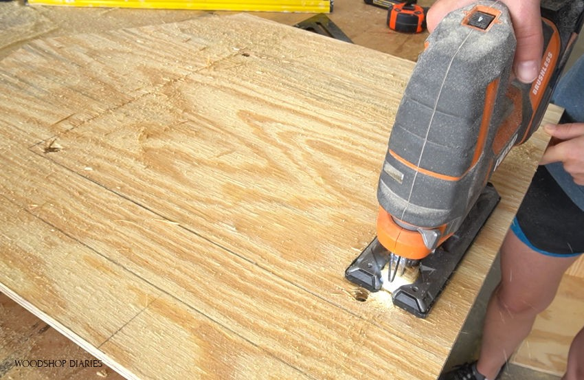 Using a jig saw to trim hole for door opening on blessing box