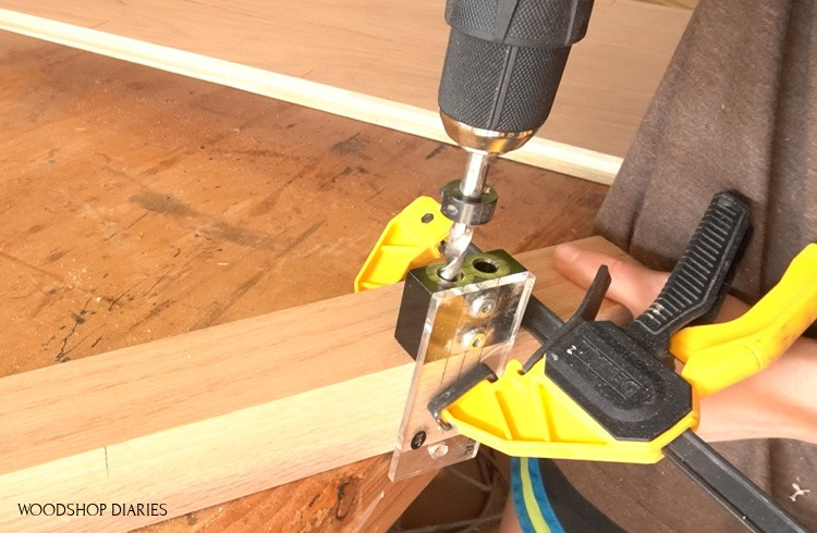 Dowel jig clamped to corner desk post to drill dowel holes for assembly