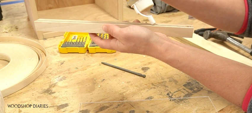 Applying clear glue to handle dado grooves