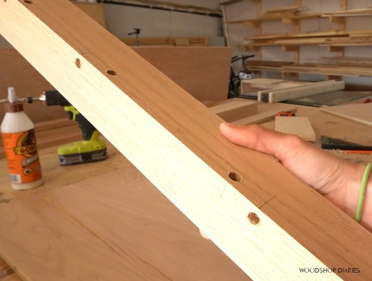 Dowel holes drilled in corner desk leg post for assembly