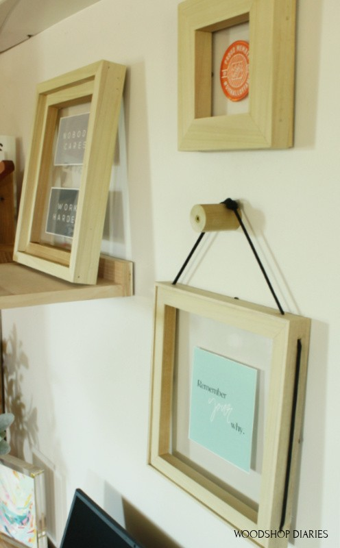 simple floating frames hanging on wall above office desk
