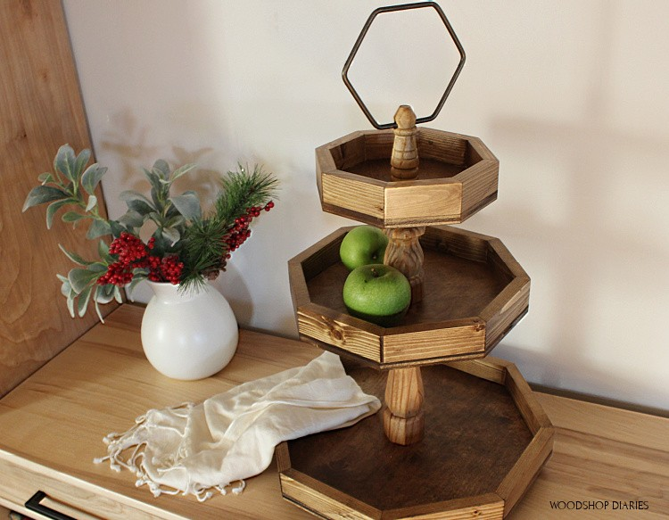 Overhead look of DIY wooden 3 tier tray made from scrap wood and furniture legs