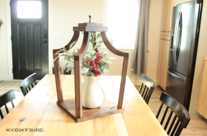 DIY wooden lantern on kitchen table top staged as centerpiece