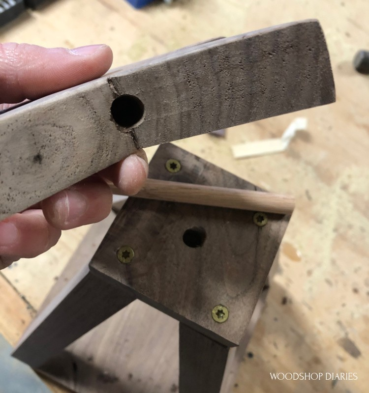 Holes drilled for dowel rod to attach star to top of stackable Christmas tree shelf
