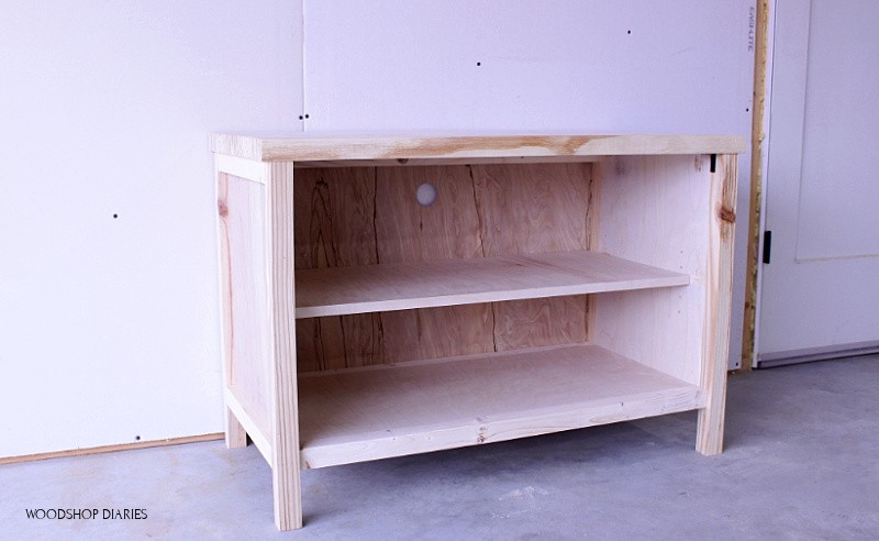 Basic unfinished shelf cabinet for tv stand with hole cut in back