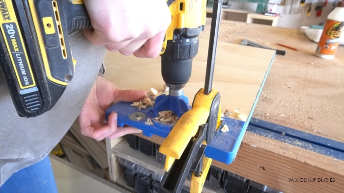Using concealed hinge jig to drill hinge cup holes