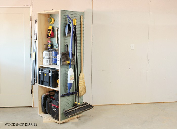 Pegboard on the side of DIY garage storage cabinet